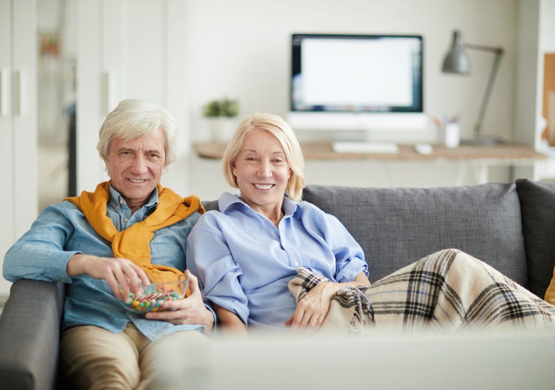 modern-senior-couple-watching-tv.jpg
