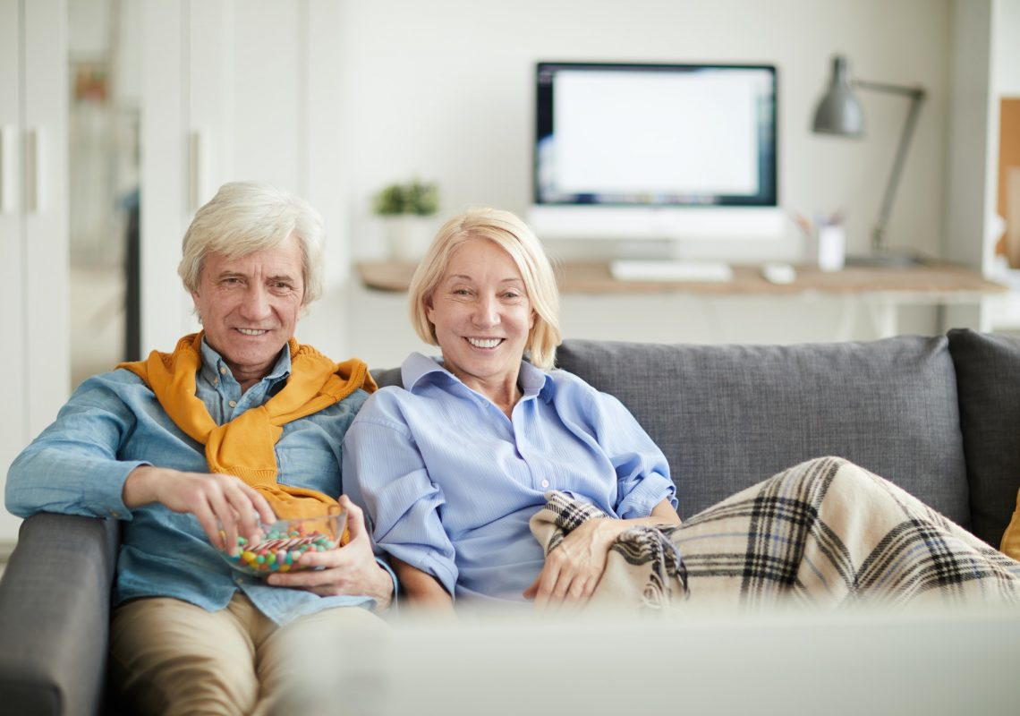 modern-senior-couple-watching-tv.jpg